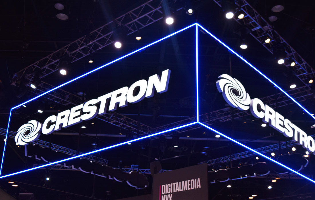 Crestron lighting up the exhibition hall with their neon blue sign.